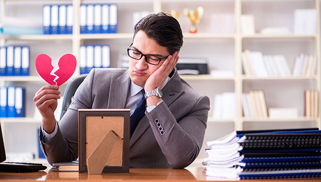 sad businessman on valentines day - 123RF