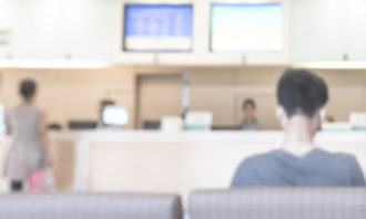 people-making-payment-at-clinic-iStock
