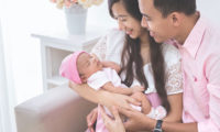 Asian-family-holding-new-born-123RF