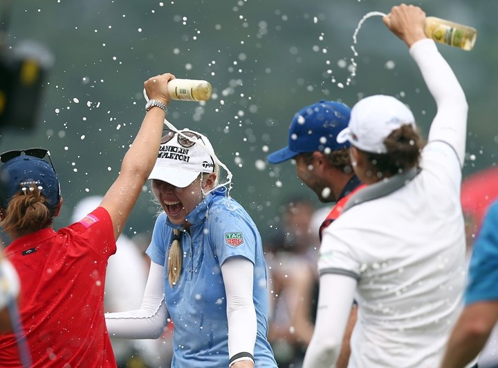 Jessica Korda is splashed with water on the 18th hole after winning the final round at Sime Darby LPGA 2015