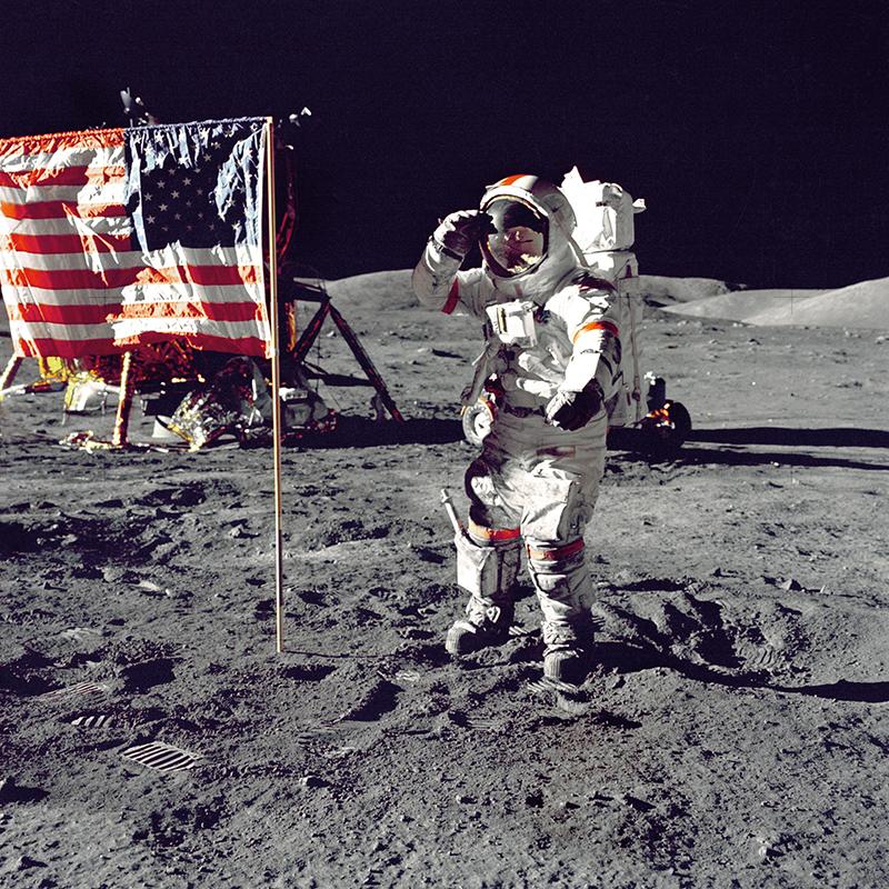 NASA astronaut Eugene Cernan salutes the American flag on the moon.