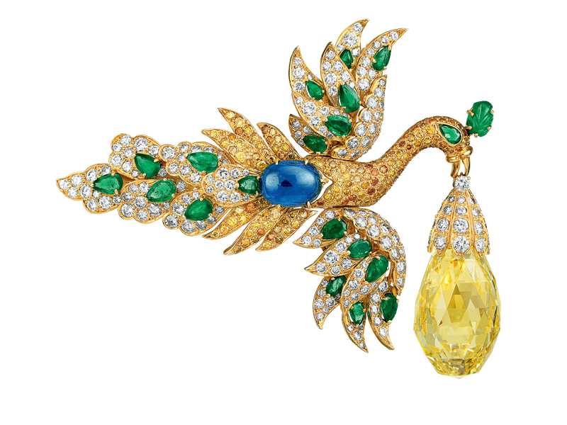 Bird gold clip with sapphire, emeralds, yellow and white diamonds.