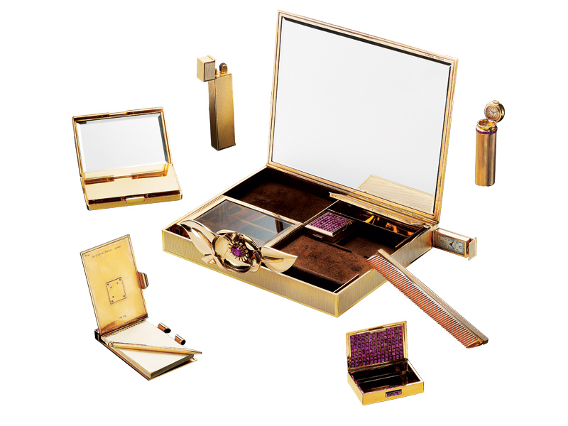 Wild Rose Minaudiere gold vanity case with Mystery Set rubies.