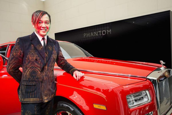 "Hung specially flew to England to commission a fleet of 30 bespoke ""Stephen Hung red"" Rolls-Royce Phantoms for The 13 Hotel."