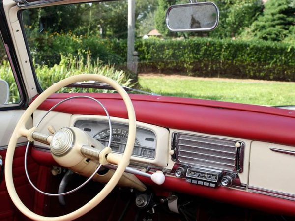 Sample interior of a rare red 1959 Peugeot 403