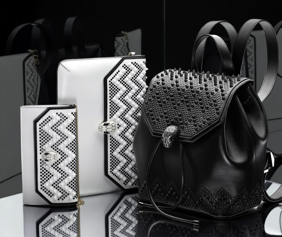 From left: Serpenti Forever Wallet on chain, Stud Chevron White Ceramic/Black/Calf leather Ceramic White; Serpenti Forever Envelope clutch, Stud Chevron White Ceramic/Black/ Calf leather Ceramic White/Light gold; Serpenti Forever Backpack, Stud Chevron black/Smooth calf leather black. Retail price: SG$1470, $1560 and $4330