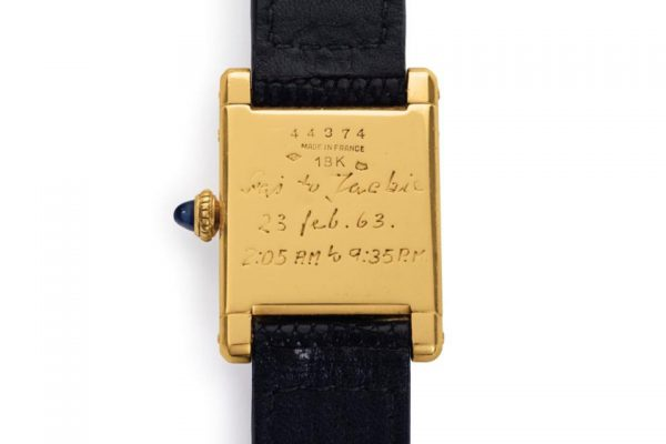"Caseback engraving of The Jacqueline Kennedy Onassis Cartier Tank with engraving from Prince Stanislaw ""Stas"" Radziwill commemorating the 50-mile hike"