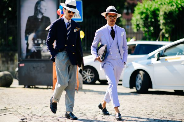 This shot of Pitti Uomo 92 by Adam Katz Sinding shows a couple of Asian gents socklessly cavorting down the pebbled stone streets of Florence.
