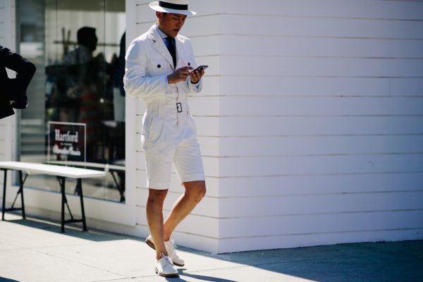 This shot of Pitti Uomo 92 by Adam Katz Sinding shows how men can pull of a smart-casual short suit with safari jacket.