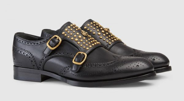My recommendation? The Gucci Queercore brogue monk shoe: A double-strap monk style shoe mixes traditional brogue details with a punk aesthetic. Rounded studs and metal feline head embellish the front.