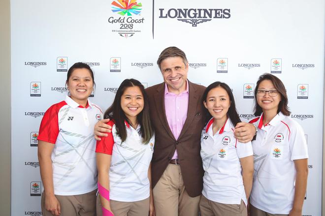 Singapore sport shooters Shun Xie Teo, Martina Veloso, and Jasmine Ser with Longines Vice President Juan-Carlos Capelli