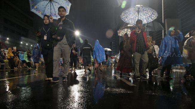 Ilustrasi hujan deras. [Suara.com / Alfian Winanto]