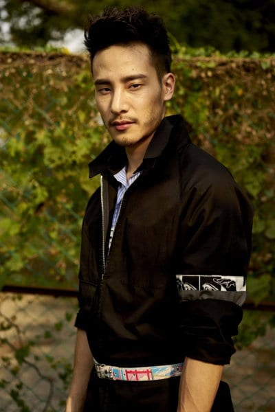 Josh Kua wearing Prada
