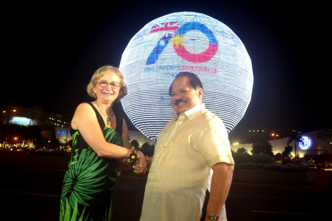 Australian Ambassador to the Philippines, Her Excellency Amanda Gorely, and National Historical Commission of the Philippines Executive Director Vic Badoy lead the lighting ceremony of the iconic MOA Globe with the 70th Anniversary logo celebrating the friendship between the Philippines and Australia.The ceremonial switch was held on May 22, 2016. Photo by Romsanne Ortiguero, InterAksyon.com.