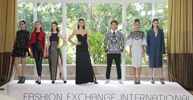 Models present clothes by various fashion designers during the press preview of Fashion Exchange International's event slated at the Marriott Grand Ballroom on July 7, 2016. Photo courtesy of FEI.