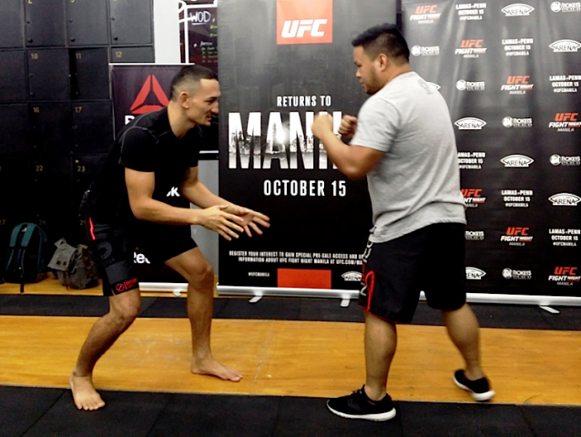 """Max Holloway demonstrates """"sprawl,"""" a defensive technique he uses in fights during a media event at SM Mall of Asia. Photo by Romsanne Ortiguero, InterAksyon."""