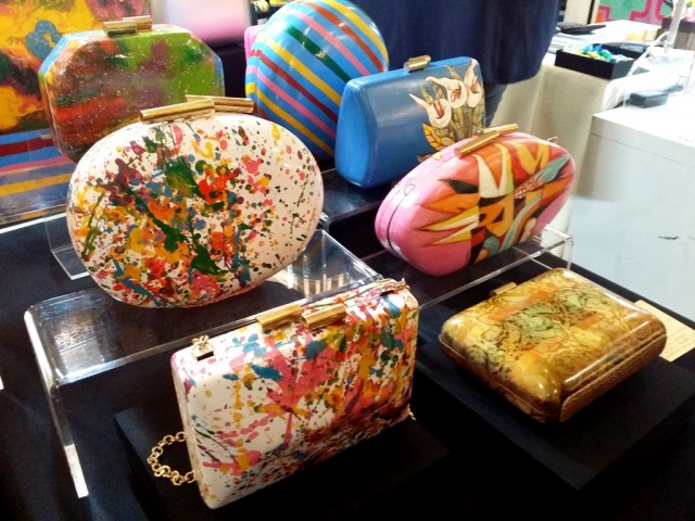 Colorful hand-painted clutches by Beatriz in collaboration with Angono artists. Photo by Romsanne Ortiguero, InterAksyon.