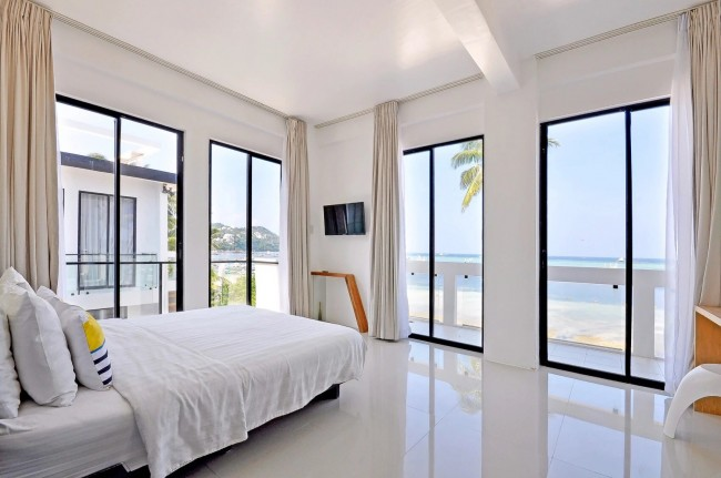 The room's white all-white color adds to the relaxing mood exuded by the beach resort. Photo courtesy of Palassa Private Residences,