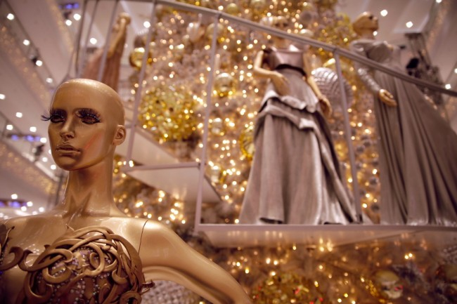 SM Mega Fashion Hall's 30-foot Christmas tree is surrounded by nine mannequins dressed up in haute couture gowns by top Filipino fashion designers. Among these creations are by Francis Libiran (foreground), Religioso (top left), and Ivar Aseron. Photo by Bernard Testa, InterAksyon.