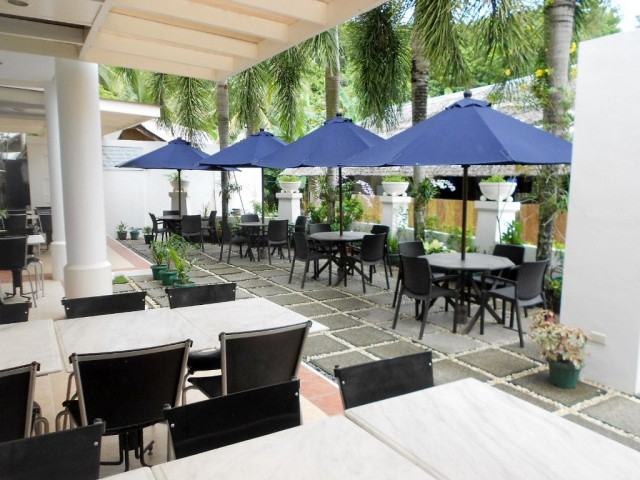The hotel's coffee shop has a patio where guests can soak up the island atmosphere. Photo courtesy One Crescent Place.