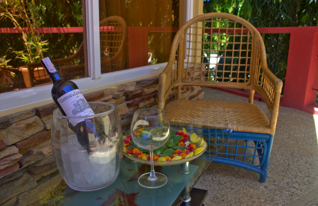 Guests can sip wine or enjoy a refreshing drink while gazing at the hotel's lush garden setting. Photo courtesy of Deep Forest Garden Inn.