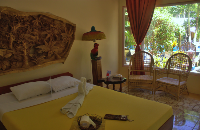 One of the spacious rooms with queen-size beds at Deep Forest Garden Inn. Photo courtesy of the hotel.
