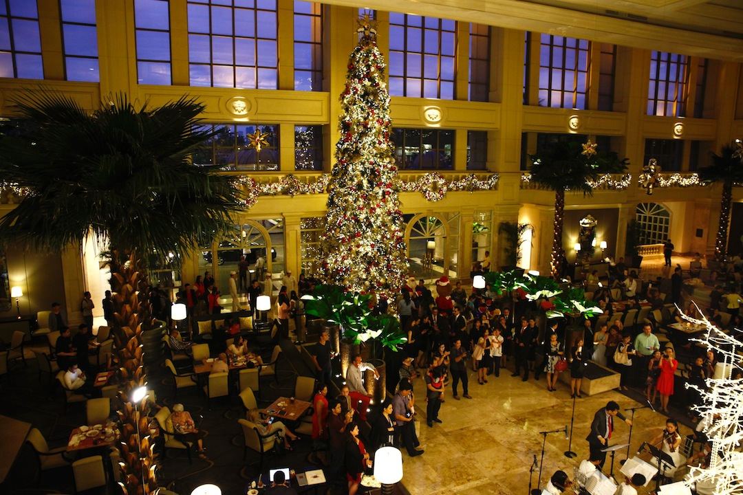 guests gather at the iconic lobby of the peninsula manila hotel during the lighting event of