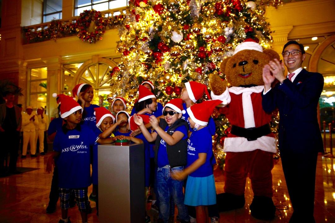 the peninsula manila gm mark choon shown here with the hotels santa bear mascot - Always Christmas