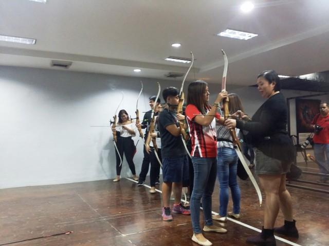 Kodanda's instructors teaching the basics of archery. Photo byRomsanneOrtiguero, InterAksyon.