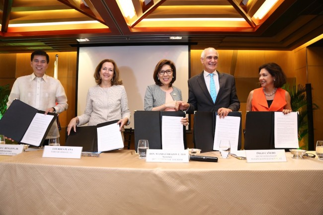 DOT Officers and representatives from Madrid Fusion sign the agreement ushering in Madrid Fusion Manila 2017 on April 6 to 8 next year. In photo, from left: DOT Undersecretary Benito Bengzon, Jr.; Lourdes Plana of Foro de Debate; Tourism Secretary Wanda Corazon Teo; Inigo Cañedo and Mielle Esteban Powel of Arum signing the Agreement for Madrid Fusion Manila 2017. Photo courtesy of the Department of Tourism.