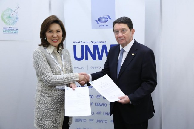 Wanda Corazon Tulfo-Teo and UNWTO Secretary General Taleb Rifai sign an agreement on the Philippines' hosting of the 6th International Conference on Tourism Statistics on June 21 to 24, 2017. DOT photo.