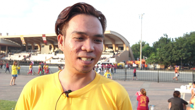 Devotee Mike Marcos, 32, says he has received miracles from the image and promises to continue passing on the tradition to the young generation. Photo by Neil Portugal, InterAksyon.