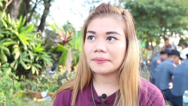 Tina Padilla, 20 years-old and a Black Nazarene devotee, says she is also praying for change for the country. Photo by Neil Portugal, InterAksyon.
