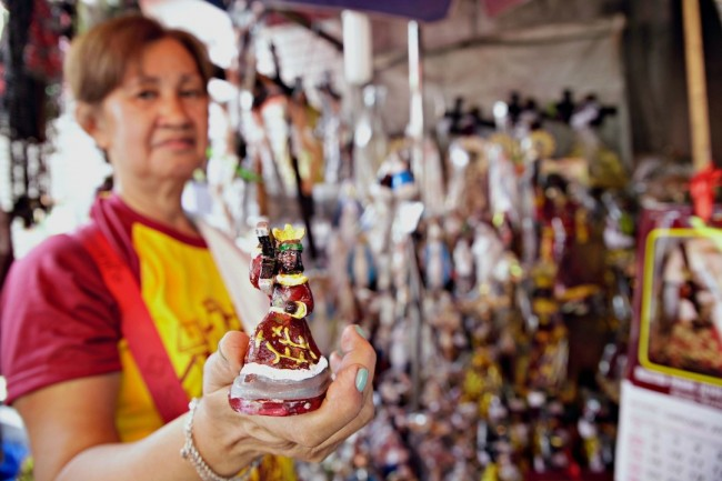 Aling Josie shows one of the Black Nazarene images in her store in Quiapo, Manila. On January 9, 2017, thousands of Black Nazarene devotees participated in the 'traslacion' procession. Photo by Bernard Testa, InterAksyon.