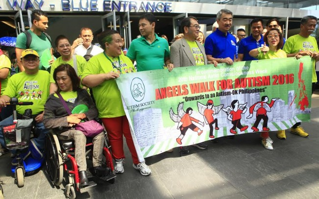 In this file photo taken during Angels Walk for Autism in 2016, Asean delegates led by Dr. Mochtan, ASEAN Deputy Secretary-General, (extreme left)  and Aliie Ninomiya, Executive Director, Asia Pacific Development Center on Disability APCD (4th from left) join Mr. Hans SY, Chairman of SM group of Companies, (3rd from right) and Senator Juan Edgardo Sonny Angara, (3rd from left). Ohters in photo are: Mona Magnao-Veluz, National President, Autism Society of the Philippines and Dang Koe, Chairman Emeritus. Photo by Bernard Testa, InterAksyon.