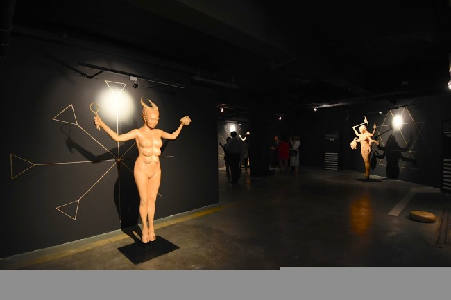 """""""Inanna,"""" a multi-breasted cow goddess is one of the celestial beings depicted in Agnes Arellano's Project Pleiades show at Art Fair Philippines, ongoing from February 16 to 19, 2017. Photo by Peter C. Marquez, InterAksyon."""