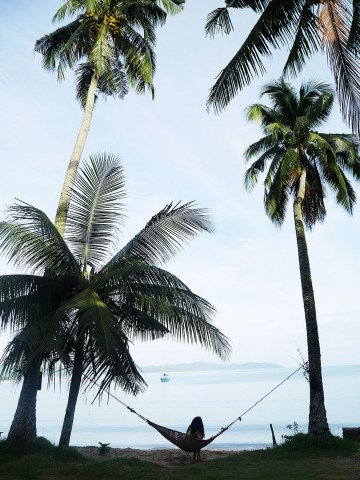 A guest lounges on the hammock by the beach in Port Barton, Palawan. Photo by Jona Branzuela Bering for InterAksyon.