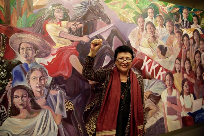 Grace Javier Alfonso, artist, professor, and curator of the exhibit also participated in the exhibit. Her mural is about women empowerment. Photo by Bernard Testa, InterAksyon.