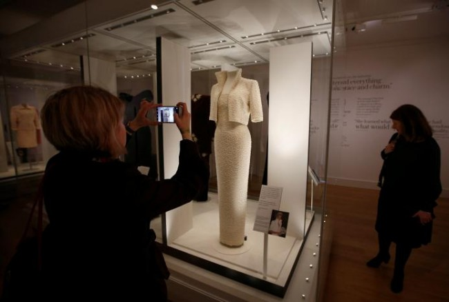 Journalists attend a preview of a new exhibition of dresses worn by the late Princess of Wales Diana, at Kensington Palace in London, Britain February 22, 2017. REUTERS/Peter Nicholls.