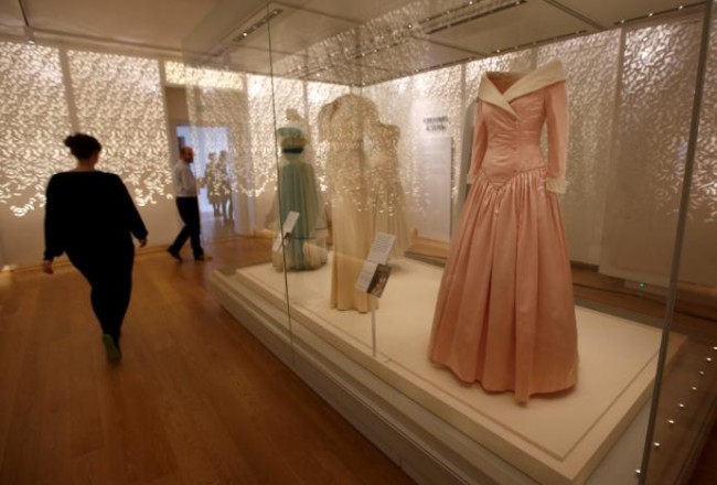 Journalists attend a preview of a new exhibition of dresses worn by the late Princess of Wales Diana, at Kensington Palace in London, Britain February 22, 2017. REUTERS/Peter Nicholls