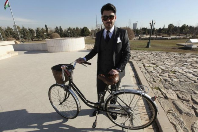 "A member of ""Mr Erbil"", a group consisting of young fashionable Kurdish men, poses in Erbil, Iraq February 4, 2017. According to its members, Mr Erbil is the first ''gentlemen's club'' in the region, and members regularly gather for photoshoots wearing outfits to promote the creations of local craftsmen.  REUTERS/Azad Lashkaril."