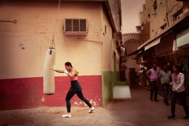 Arifa Bseiso boxes an opponent in a scene shot for the Nike Middle East ad campaign filmed in Dubai, UAE, February 13, 2017. Picture taken February 13, 2017. Nike/Handout via REUTERS.