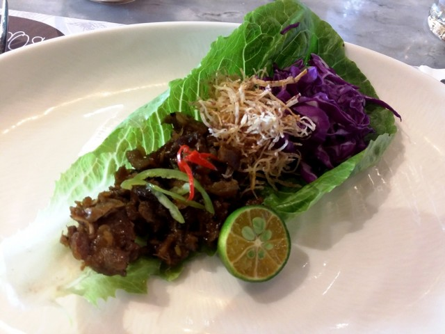 Chef Sarthou recreated some of the dishes he served at Madrid Fusion 2017 during a press conference held at his Agos restaurant. In photo is his Sisig in Lettuce Wrap. Photo by Romsanne Ortiguero, InterAksyon