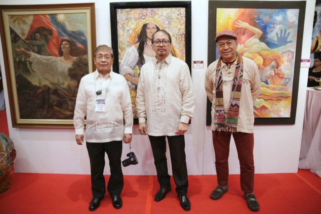 Celebrated figurative artists (from left) Romi Mananquil, August Santiago, Jr., and Nemiranda pose at the opening of their art exhibit titled 'Figura Filipina' at Robinsons Galleria on February 24, 2017. Photo by Bernard Testa, InterAksyon.