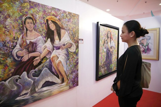 Accomplished figurative artist August Santiago, Jr.'s paintings are one of the works on view to the public at 'Figura Filipina' at Robinsons Galleria till March 4, 2017. Photo by Bernard Testa, InterAksyon.