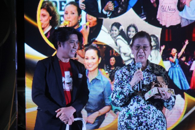 Ligaya Salonga gives a messag in behalf of her daughter, international singer and actress Lea Salonga, after the latter was given an award from Dynamic Teen Company's founder Efren Peñaflorida. The ceremony was held during the 20th anniversary celebration of DTC on Sunday, March 5, 2017. Photo by Jhun Dantes for InterAksyon.