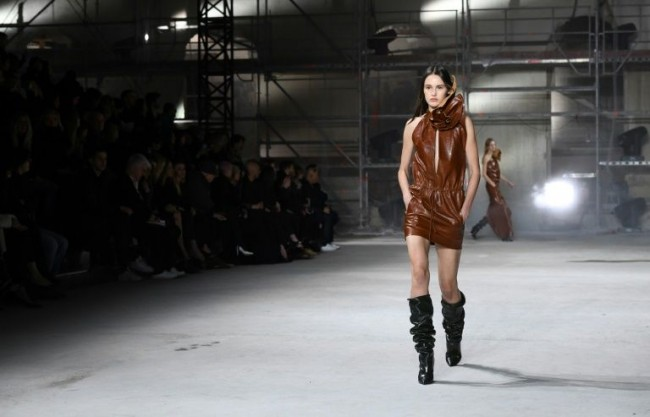 Anthony Vaccarello at Saint Laurent wrapped many of his models in rippling leather outfits. Photo by Alain Jocard/AFP.