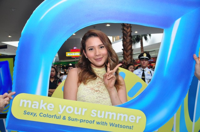 Karylle Yuzon, singer and Belo brand ambassador, poses at Watsons' 'Make Your Summer' skin protection campaign at Mall of Asia. Photo courtesy of Watsons Philippines.