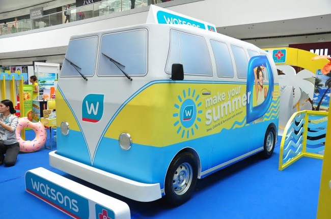 A summer-themed bus  inside the Mall of Asia in Pasay City is used by Watsons to promote its 'Make your Summer' shopping promo. Photo courtesy of Watsons Philippines.