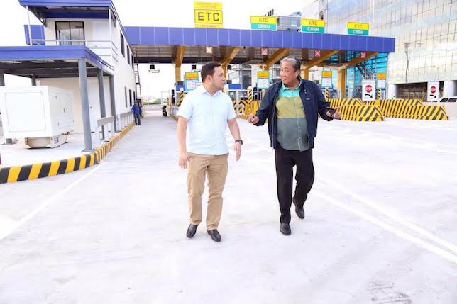 Department of Public Works and Highways (DPWH) Secretary Mark Villar (left) and Department of Transportation (DoTr) Secretary Art Tugade inspect the NAIA Expressway Christmas Lane, which opens on Wednesday December 21. Handout